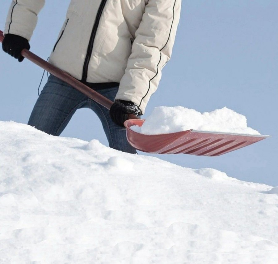 clearing snow with a shovel