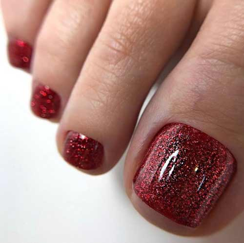 Red pedicure with glitter
