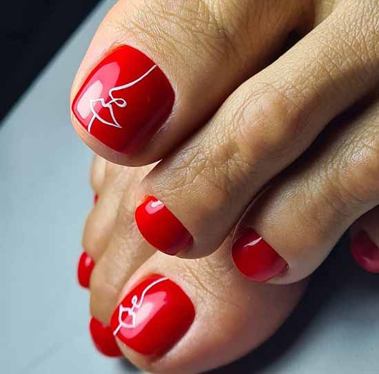 Red pedicure with white pattern