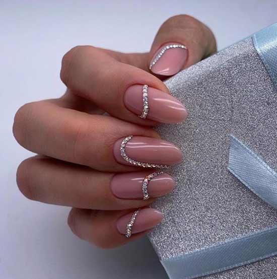 Nude and rhinestones in manicure