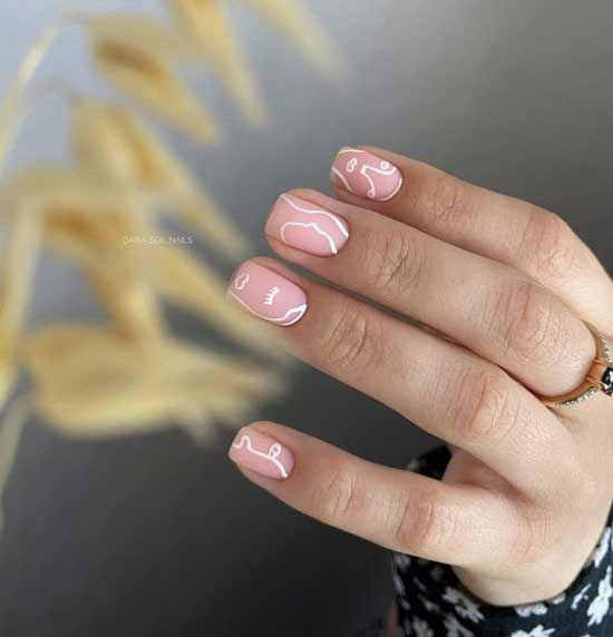 Nude manicure with a pattern