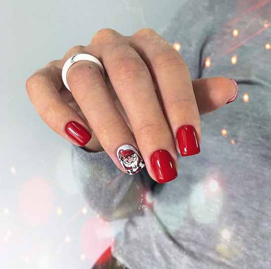 Red manicure and drawing on one nail