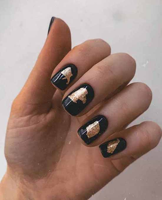 Black manicure with potal foil