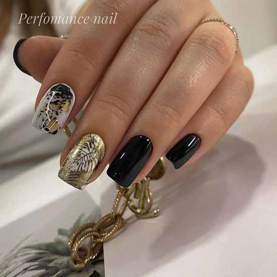 Black manicure with gold foil