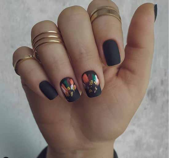 Matte black manicure with foil