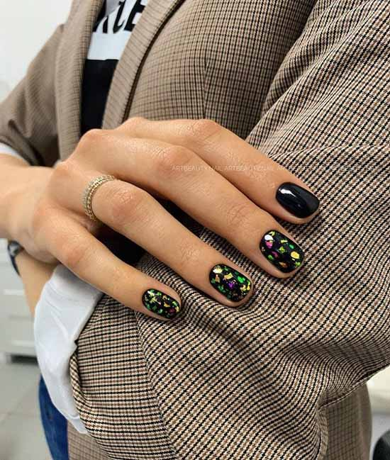 Black manicure with colored foil