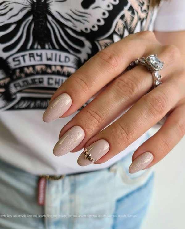 Beautiful beige glitter manicure