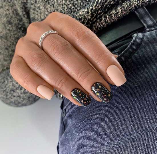 Beige and black glitter manicure