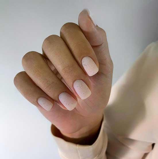 Matte beige manicure with fine sparkles