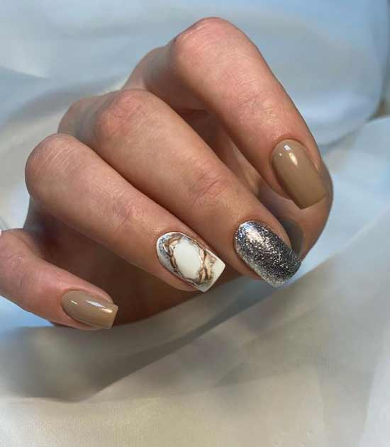 Beige nail polish and glitter designs