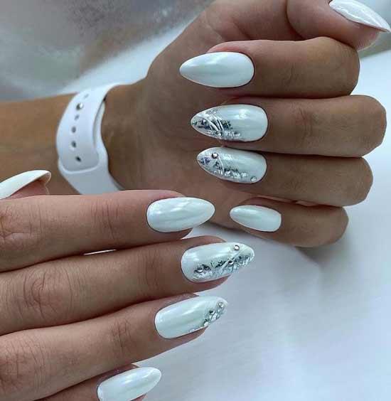 Rub-in, silver leaf and rhinestones on nails