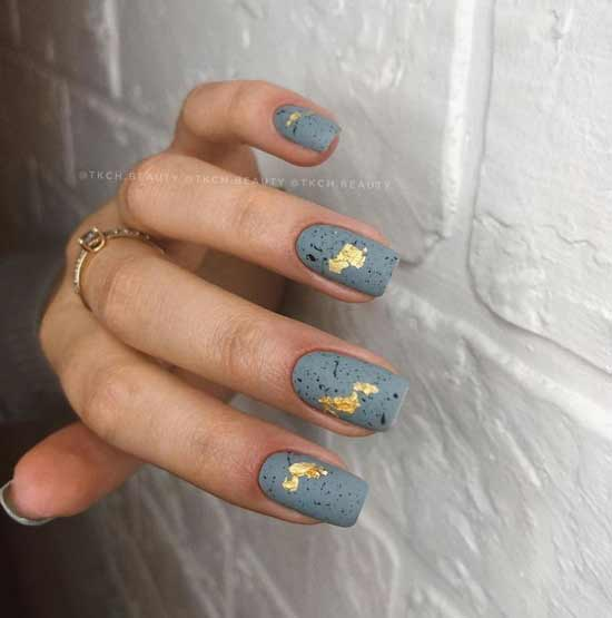 Gray matte manicure with gold leaf
