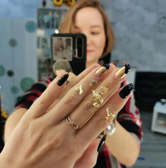 Black and white manicure with gold leaf