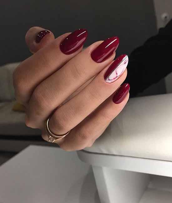 Dark red glitter manicure