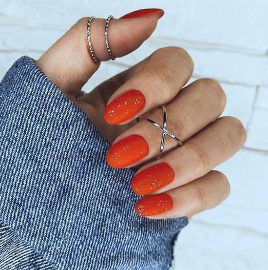Matte glitter color of manicure carrot