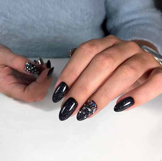 Black manicure with rhinestones and sparkles