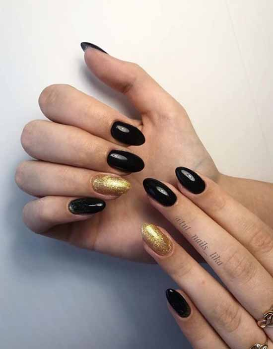 Black manicure with gold sequins