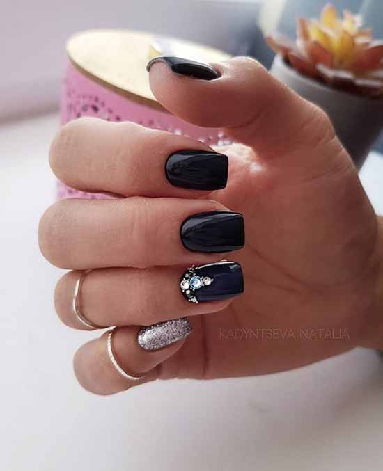 Rhinestones and sequins on black nail cover