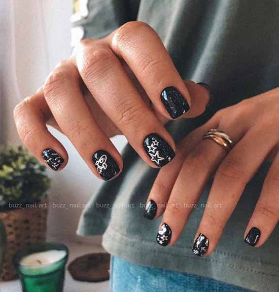 Black manicure with glitter and stickers