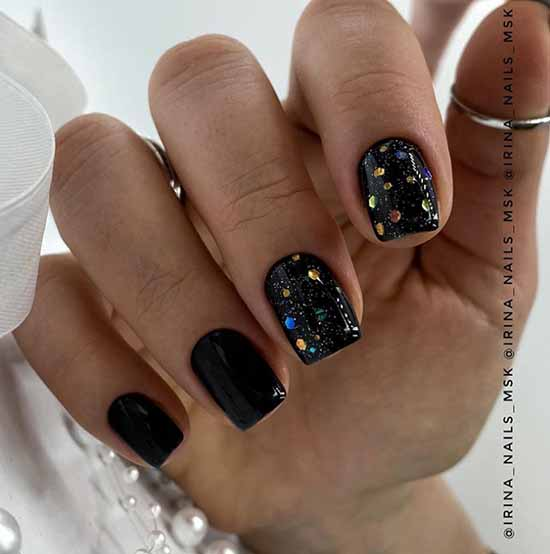 Black manicure with multi-colored sequins