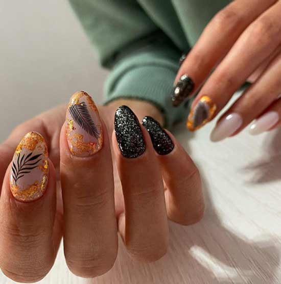black manicure and gold sequins