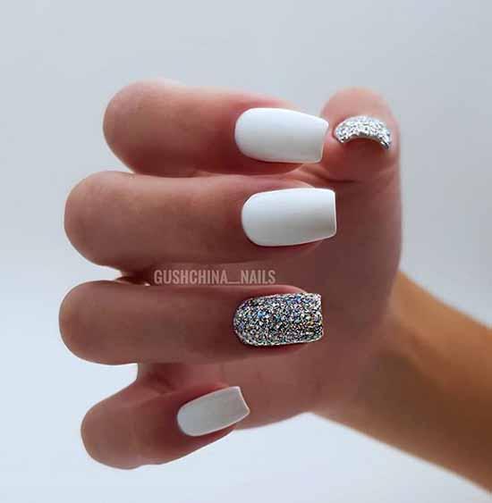 White manicure with silver decor