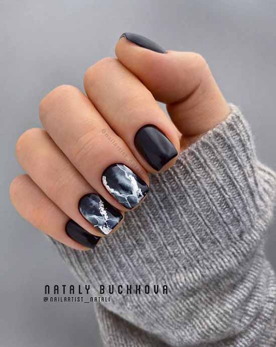 Black nail design with silver