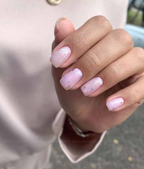 Beautiful manicure short nails and silver