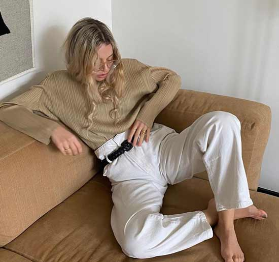 White trousers with black belt