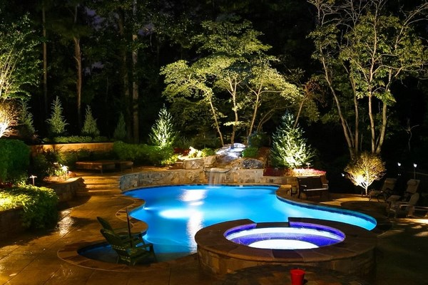 Decorative lighting of the recreation area with a pool