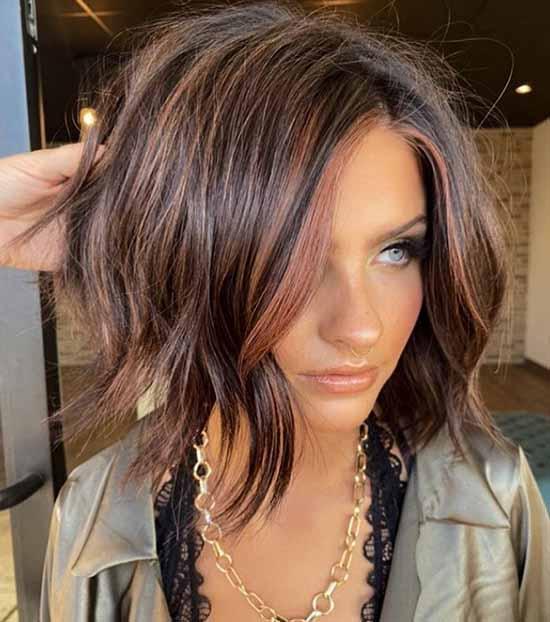 Fashionable short haircut with long bangs