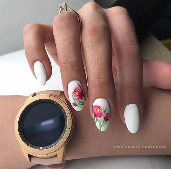 White manicure with a bright pattern