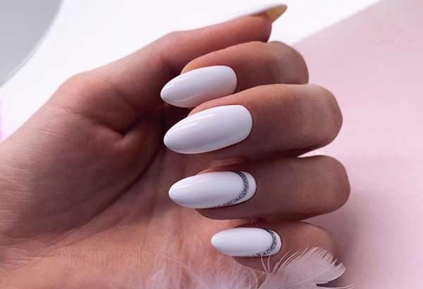 Beautiful white manicure with decor