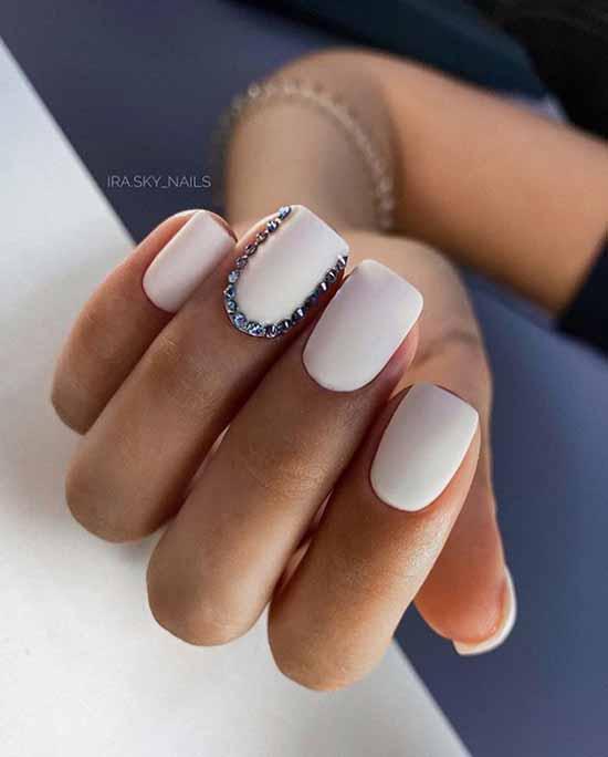 White manicure design rhinestones