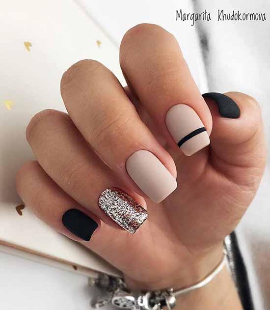 Black and beige manicure and glitter decor