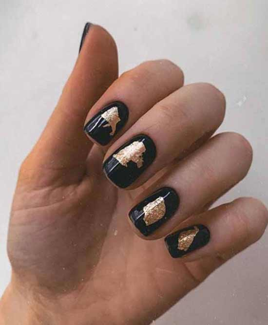 Black manicure with foil