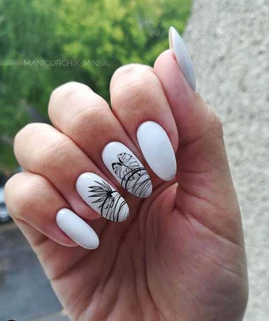 White manicure with spiderweb