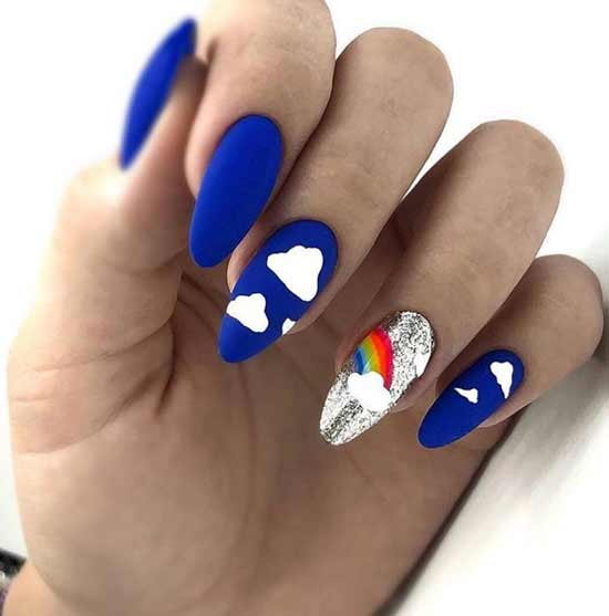 Bright manicure with clouds