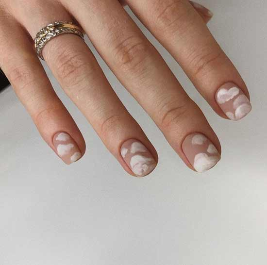 Matte beige manicure with clouds