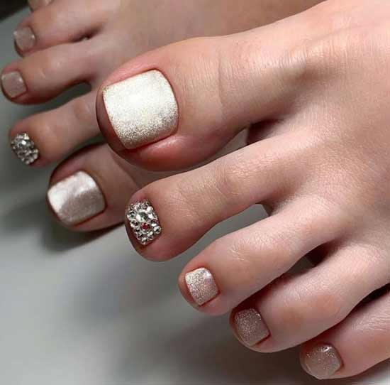Sequins and rhinestones pedicure design