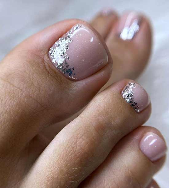 Nude pedicure with glitter and foil