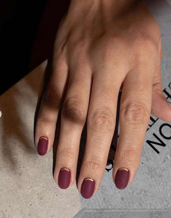 Autumn nail art in burgundy color
