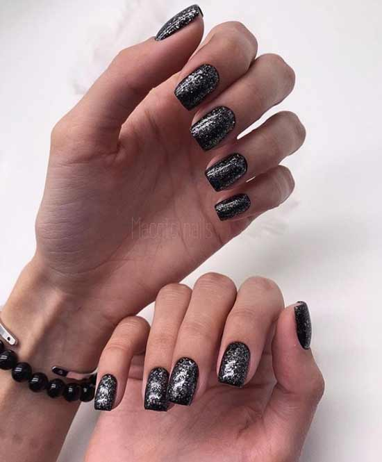 Black nails with autumn designs
