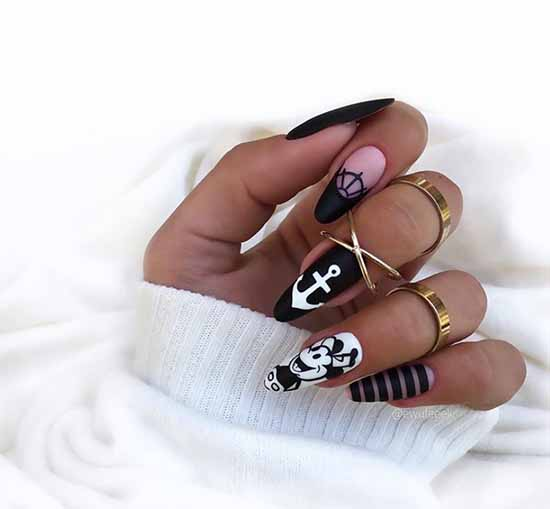 Black with drawings manicure