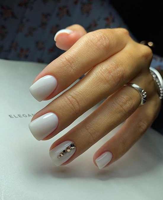 Milk manicure with rhinestones