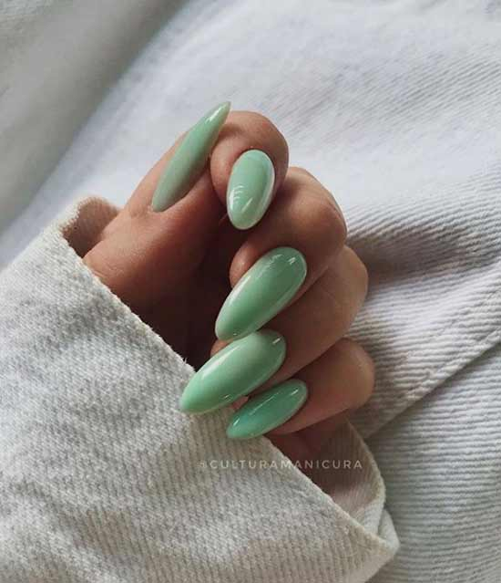 Mint manicure long nails tanned hands