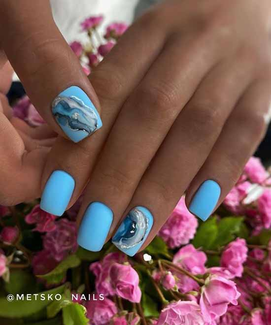 Blue nail design on tanned hands