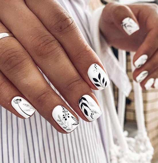 White manicure looks beautiful on tanned hands