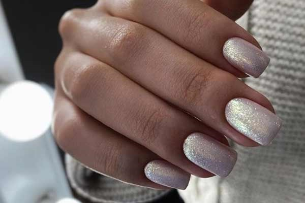 Shiny manicure for tanned hands