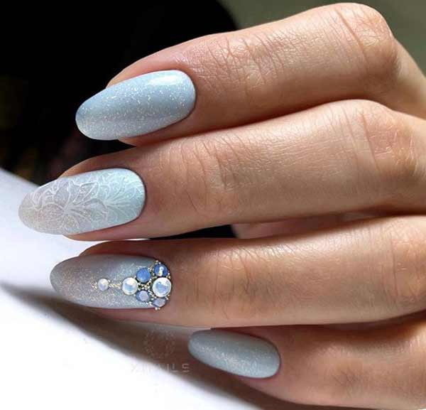 Blue New Year's manicure with rhinestones